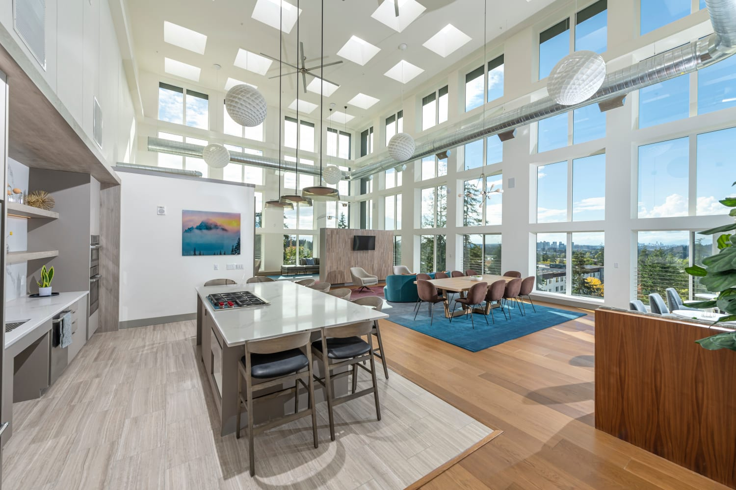 Resident lounge with kitchen and media area at Nightingale in Redmond, Washington