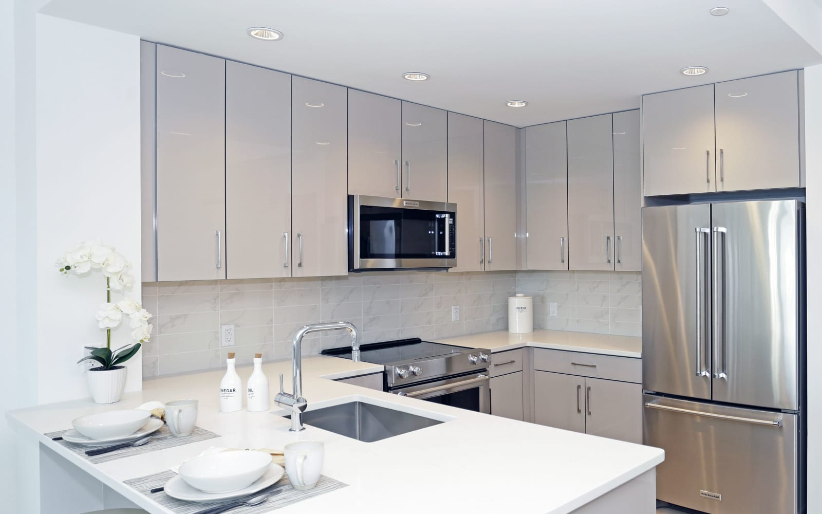 Apartment kitchen with white appliances  at The Centre