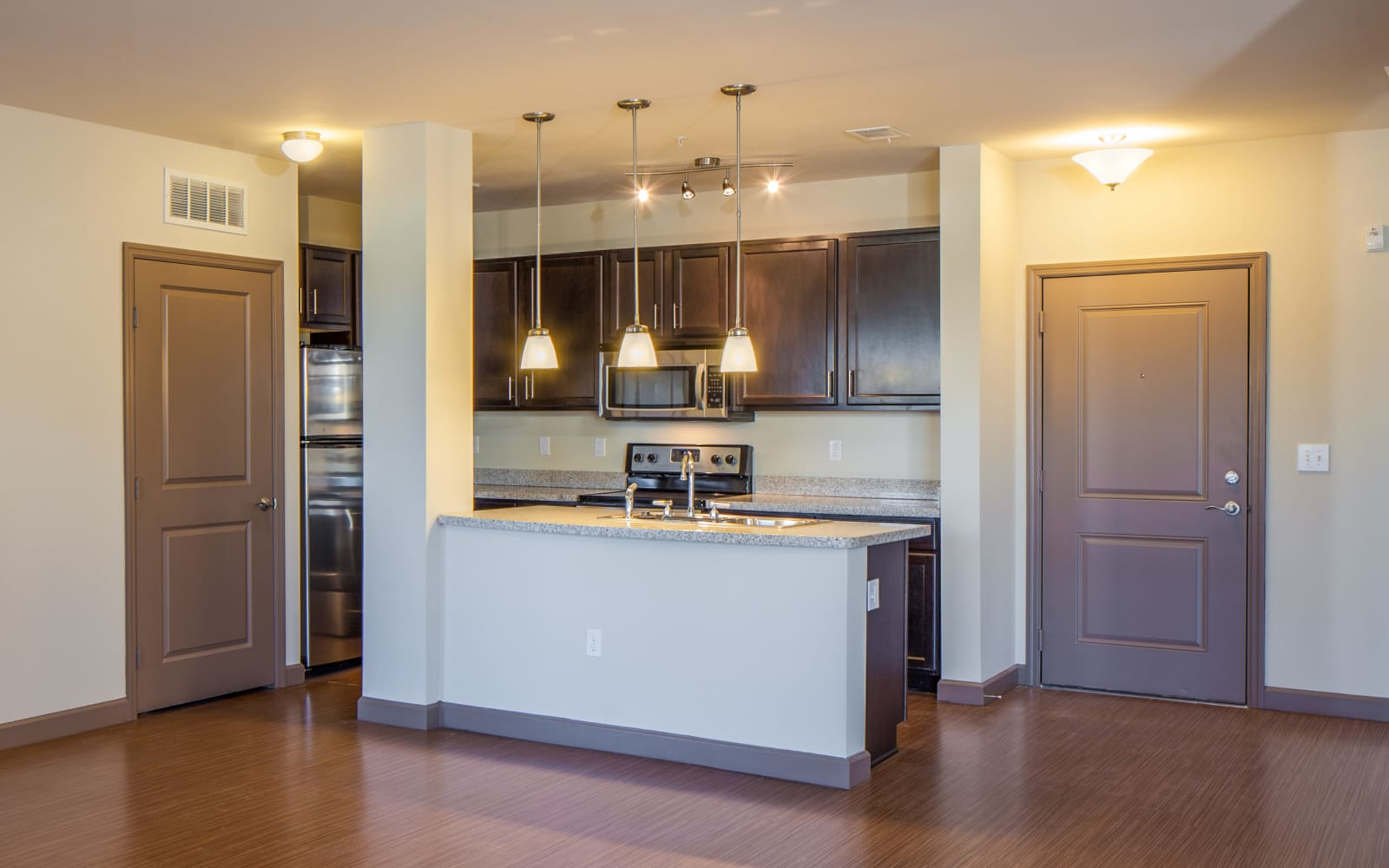 Model living room and kitchen at The High Grove in Baton Rouge, Louisiana
