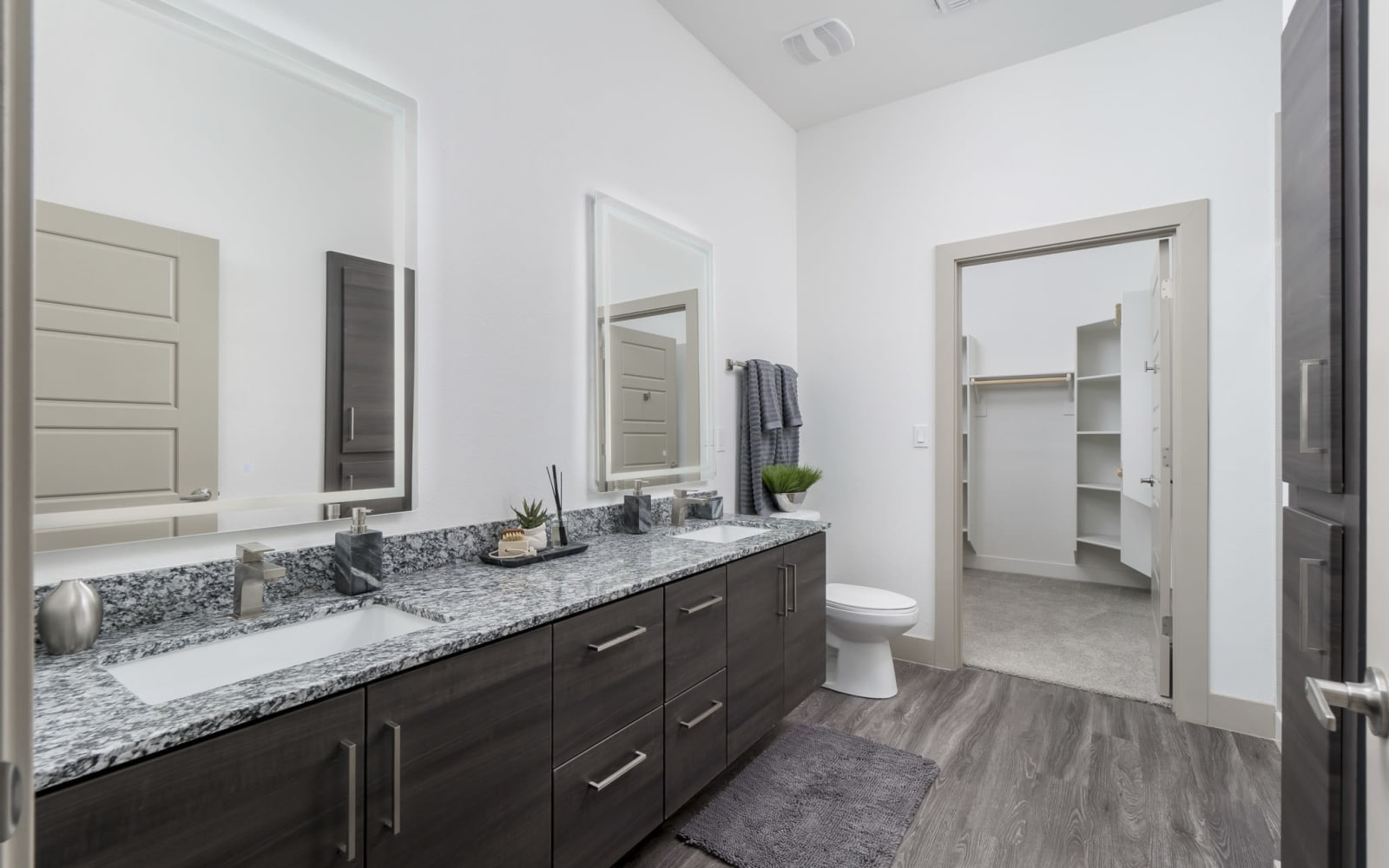 Bathroom leading to the walk-in closet at The District at Scottsdale in Scottsdale, Arizona