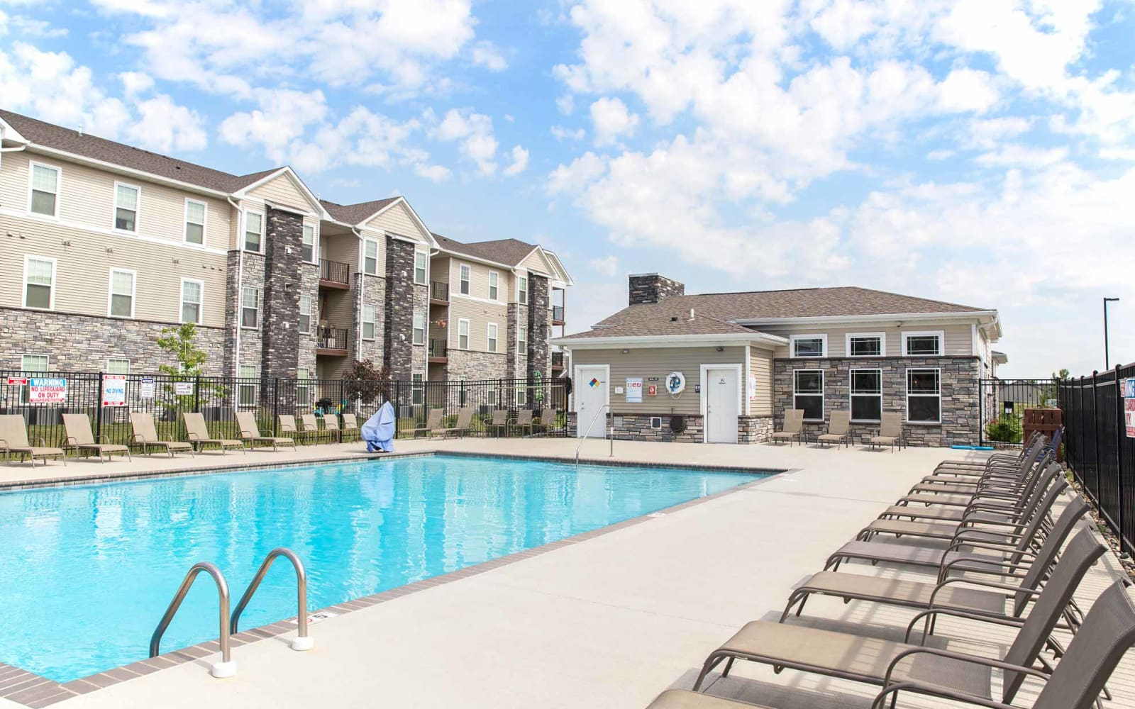 Large community pool with pool side seating at Ironwood in Altoona, Iowa