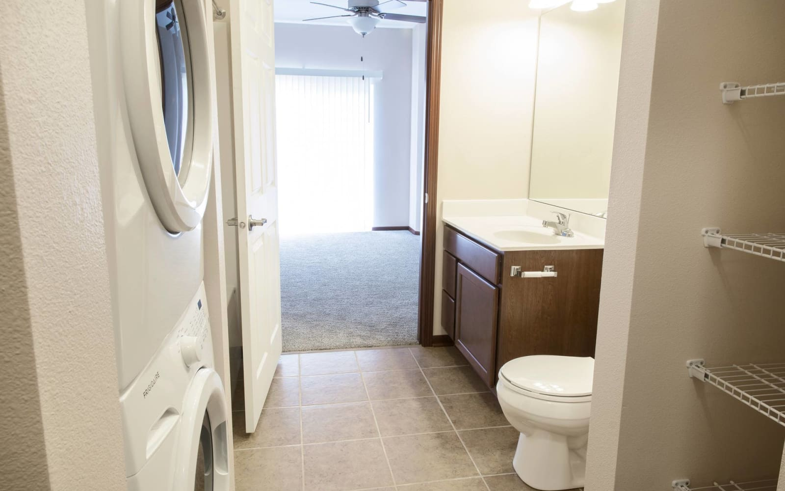 Apartment bathroom with storage space and a washer and dryer at Ironwood in Altoona, Iowa