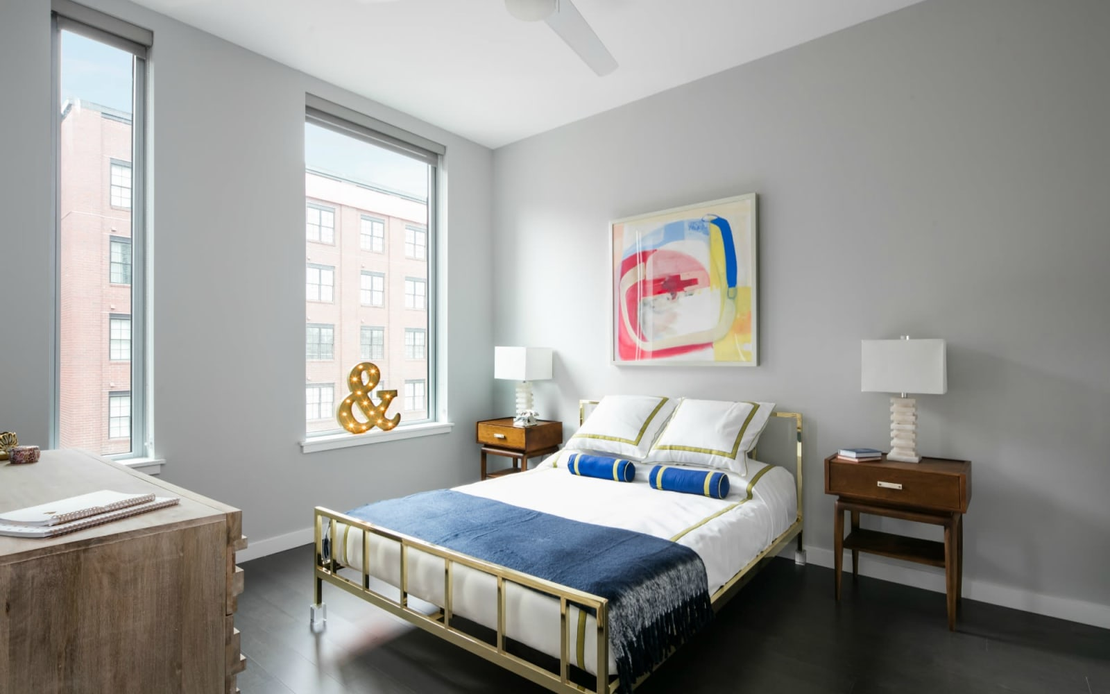 Model bedroom with natural light at The Beacon at South Market in New Orleans, Louisiana