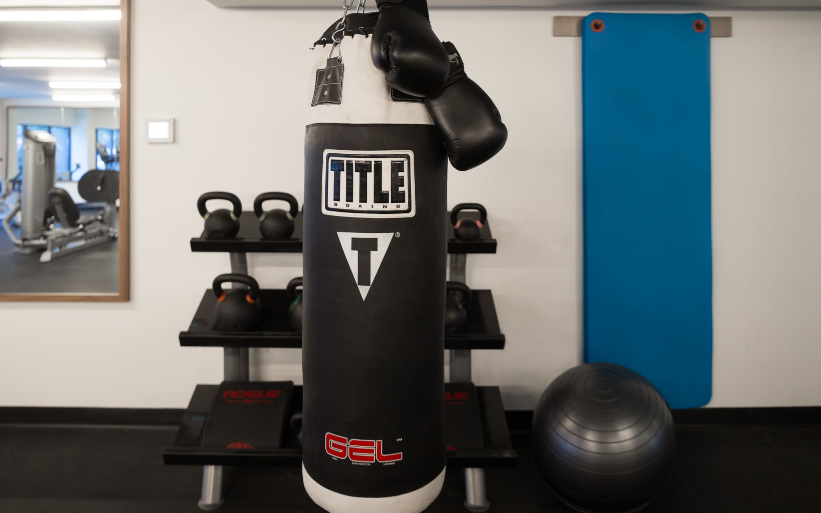 Punching bag and free weights at Eleven33 in Brooklyn, New York