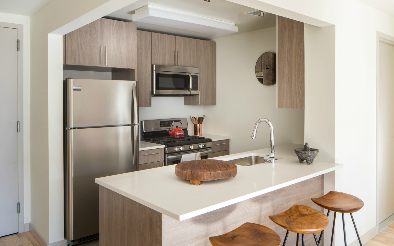 Kitchen with stainless steel appliances at Eleven33 in Brooklyn, New York