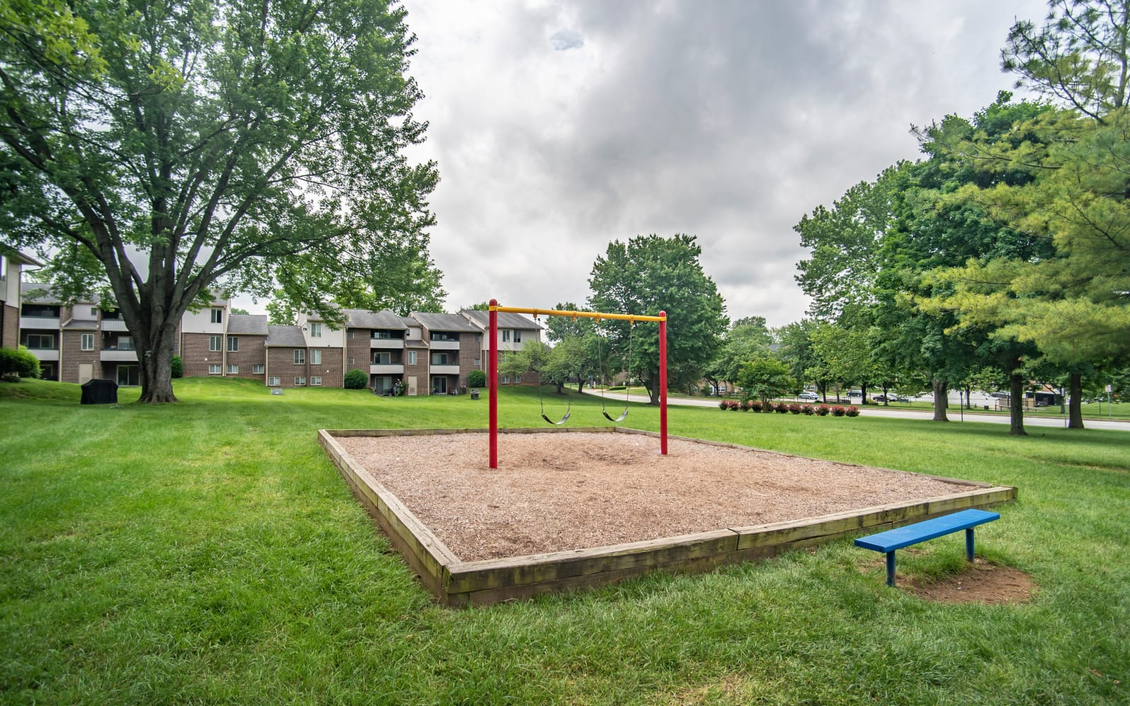 Swings with a bench nearby at Hunt Club Apartments in Cockeysville, Maryland