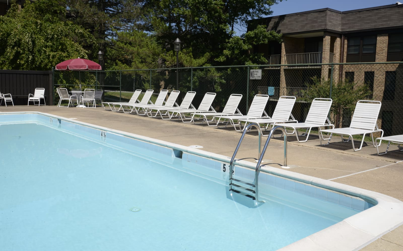 Swimming pool and chairs at Charlesgate Apartments in Towson, Maryland