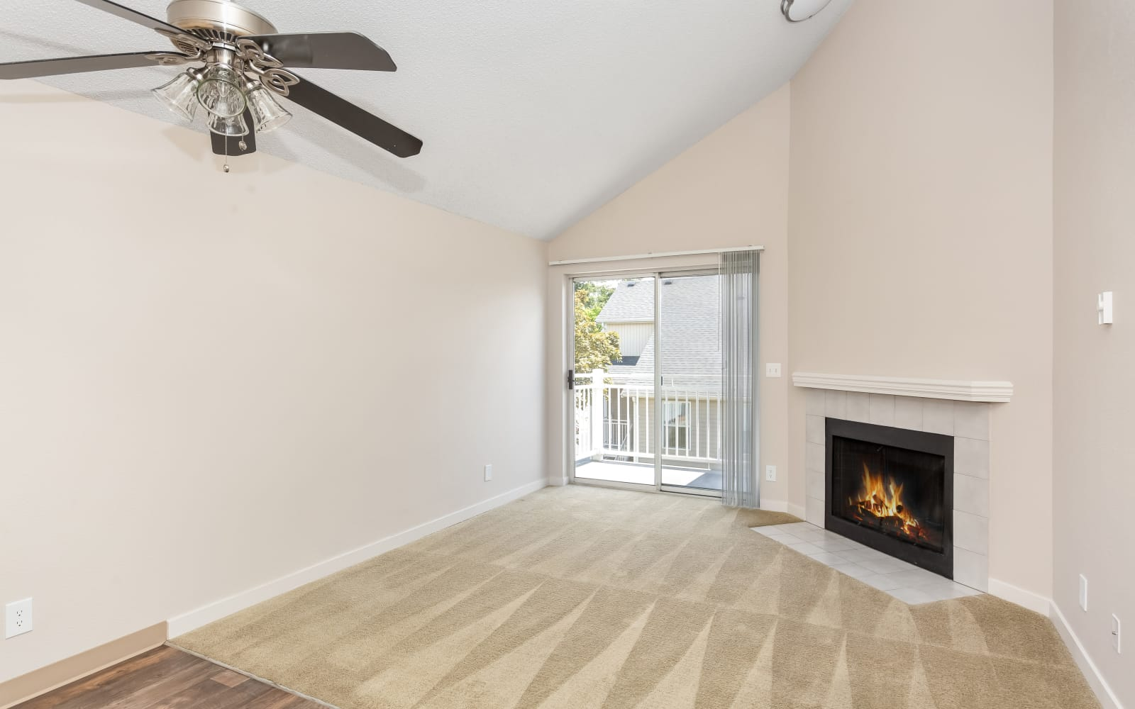 Spacious room with ceiling fan at Alaire Apartments in Renton, Washington