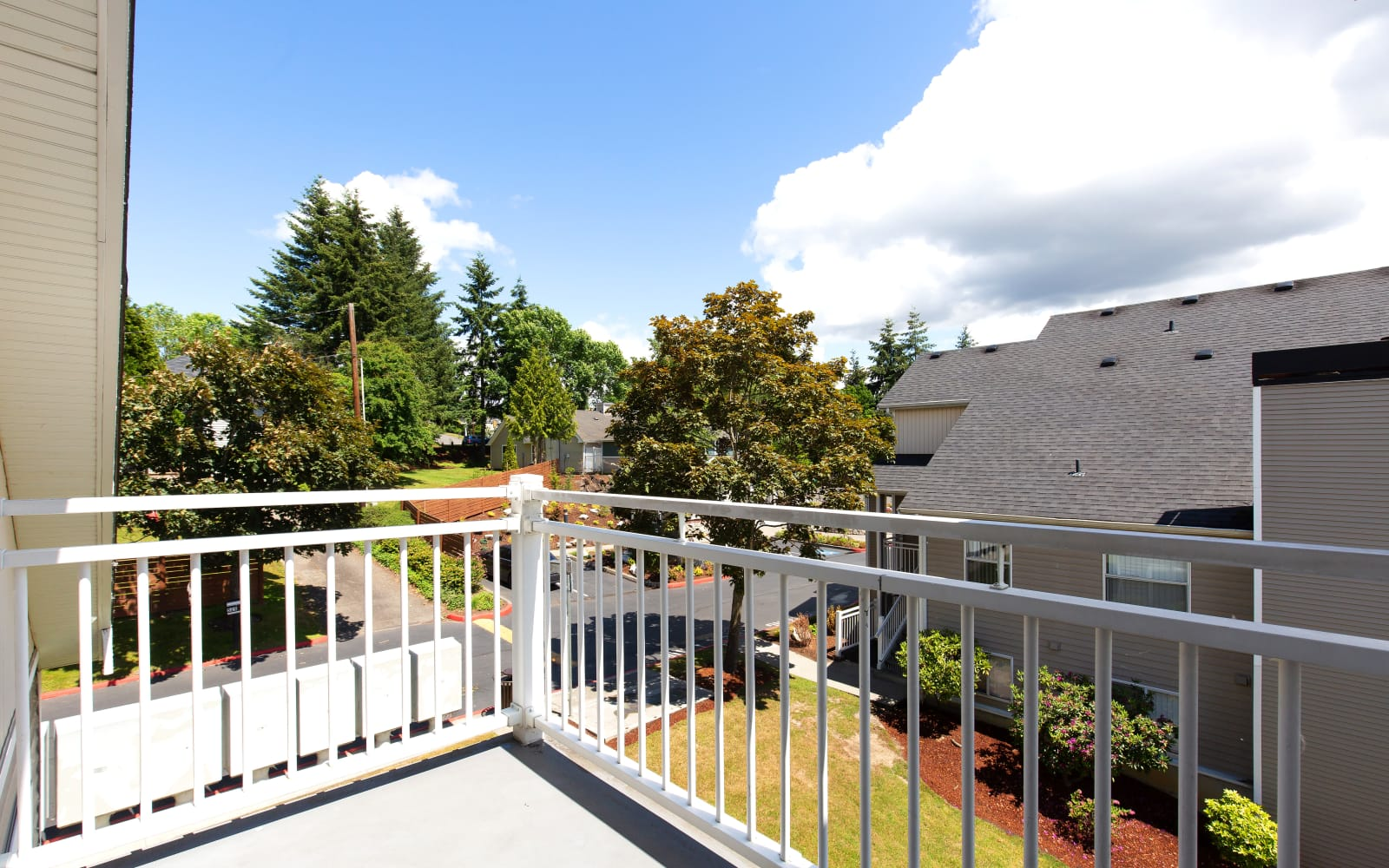 Balcony featuring a beautiful view of the wonderful landscaped grounds at Alaire Apartments in Renton, Washington