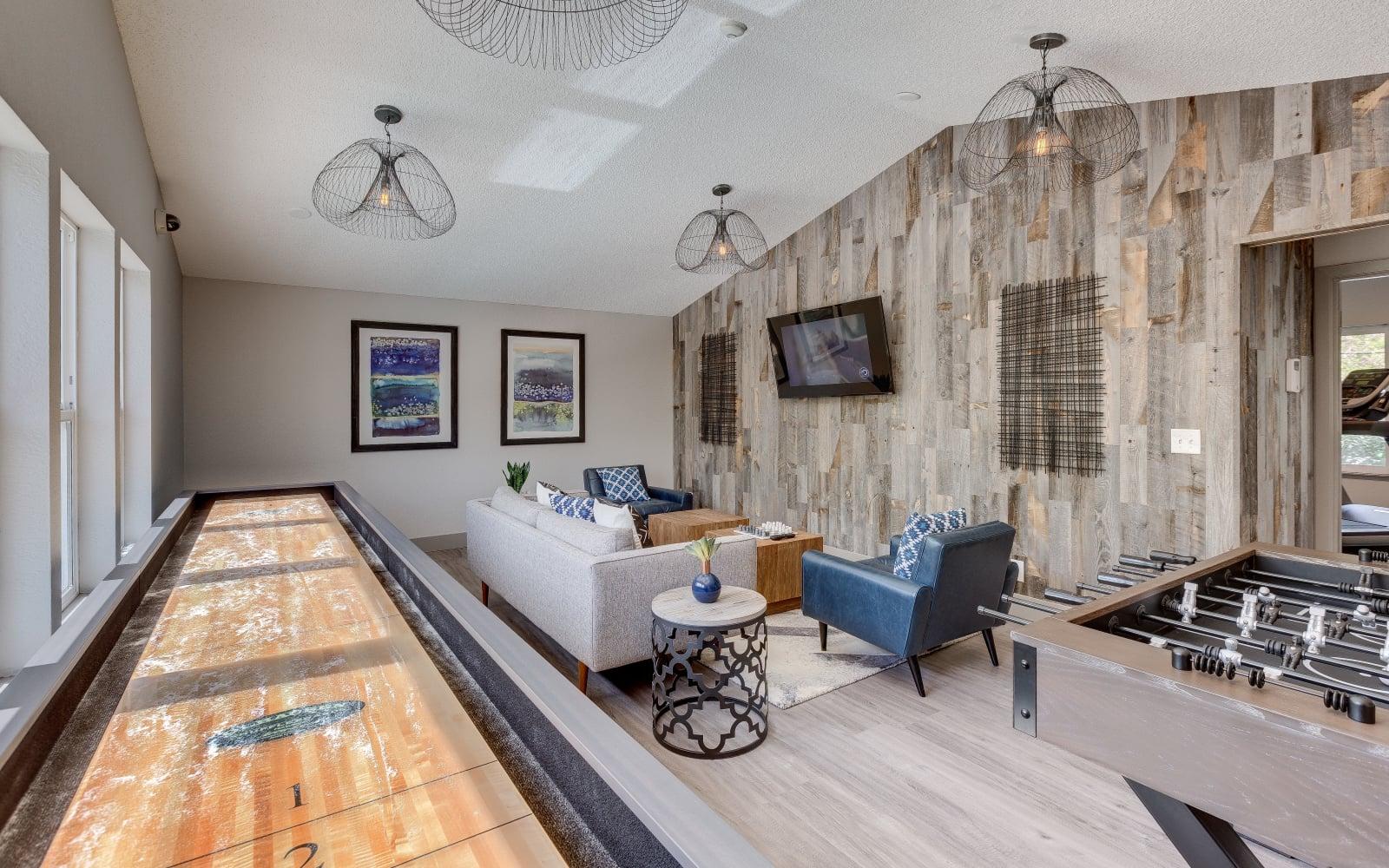 Shuffleboard table at Alaire Apartments in Renton, Washington