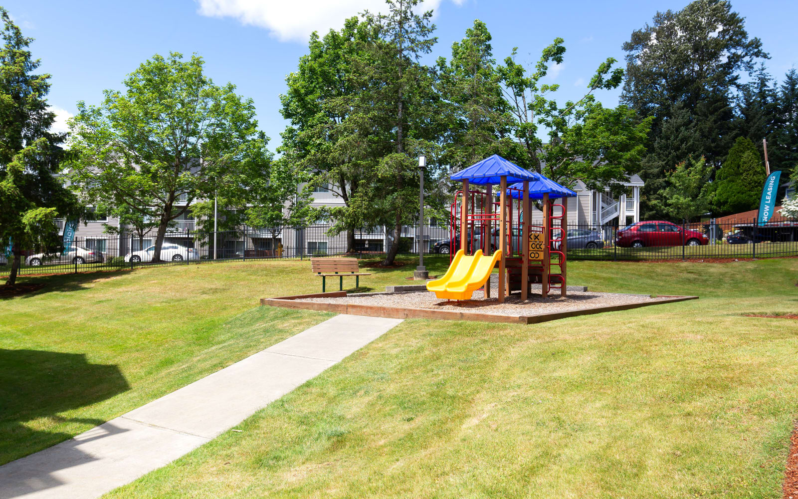 Playground on a beautiful day at Alaire Apartments in Renton, Washington