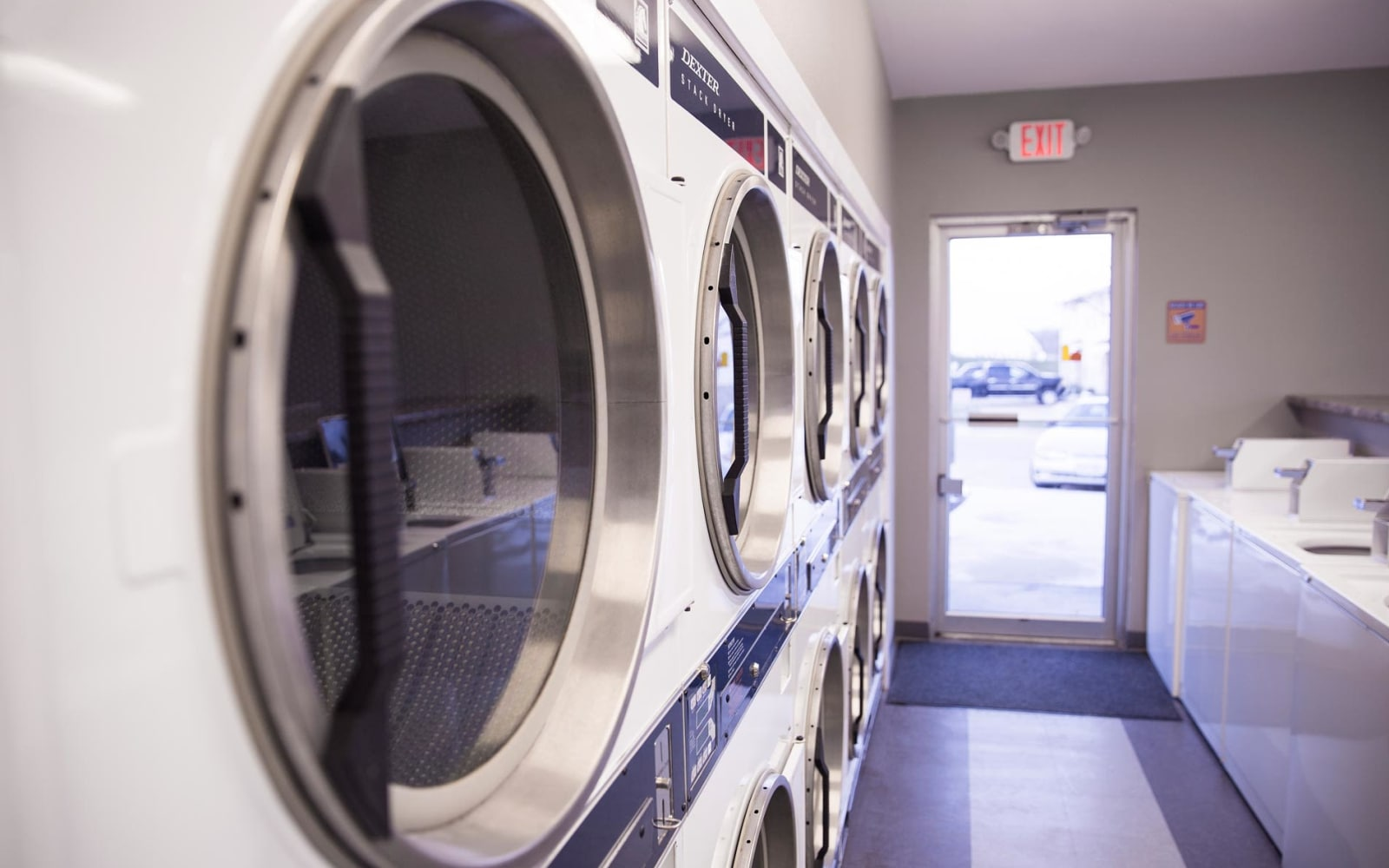 Dryers in the laundry room at Campus View & Kirkwood Court in Cedar Rapids, Iowa