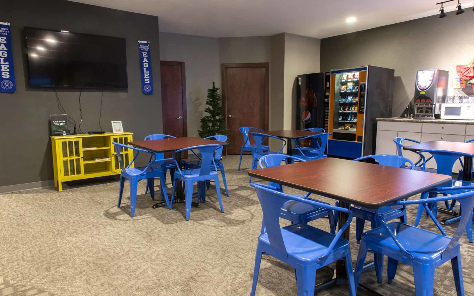 Seating near the television in the clubhouse at Campus View & Kirkwood Court in Cedar Rapids, Iowa