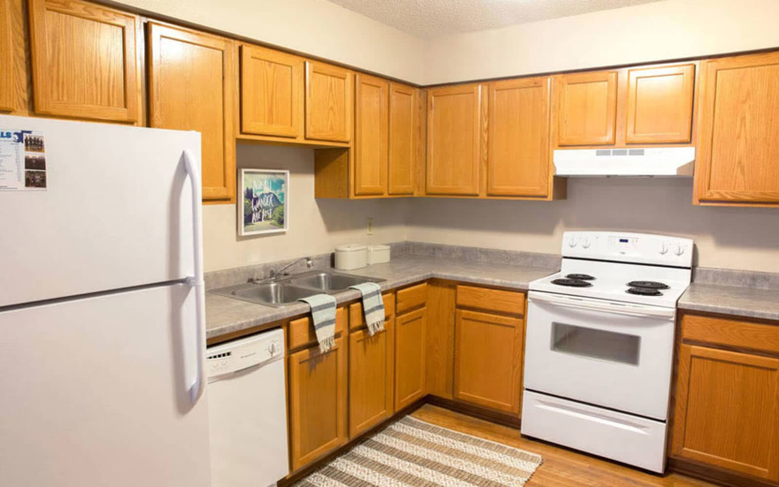 Apartment kitchen at Campus View & Kirkwood Court in Cedar Rapids, Iowa