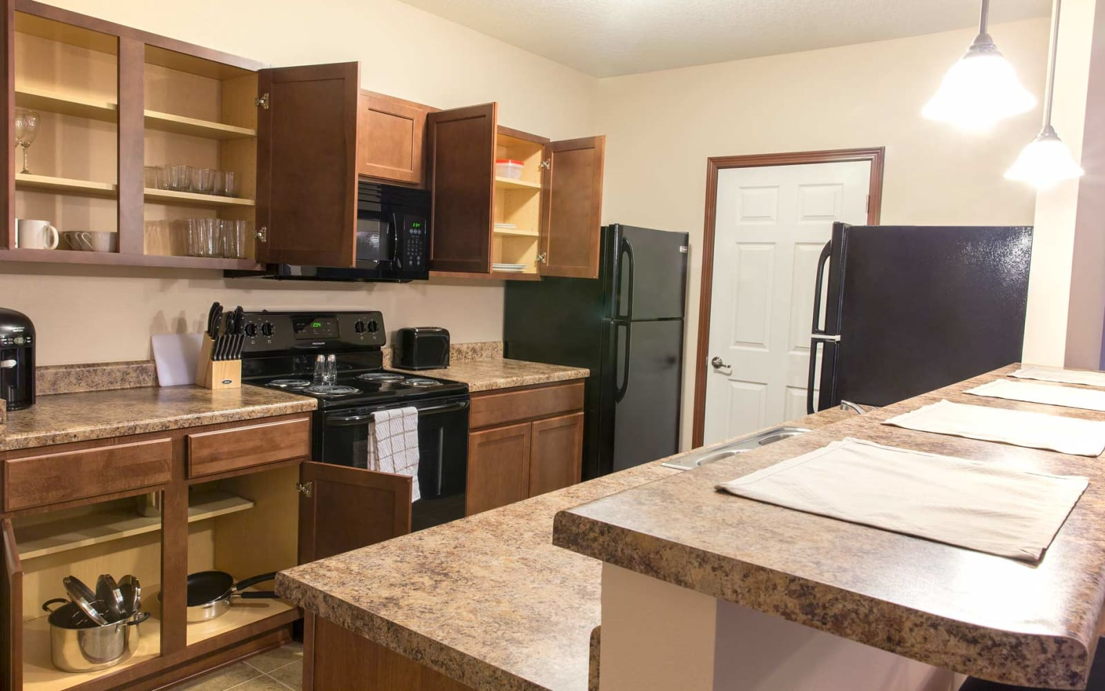 The kitchen cabinets have plenty of storage space at Prairie Pointe Student Living in Ankeny, Iowa