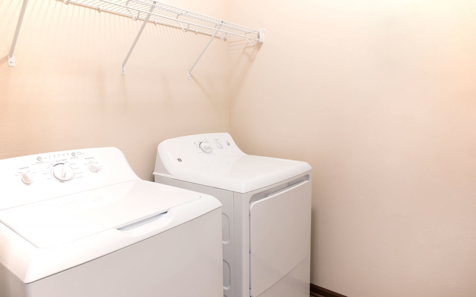 A full size washer and dryer in an apartment at Prairie Pointe Student Living in Ankeny, Iowa