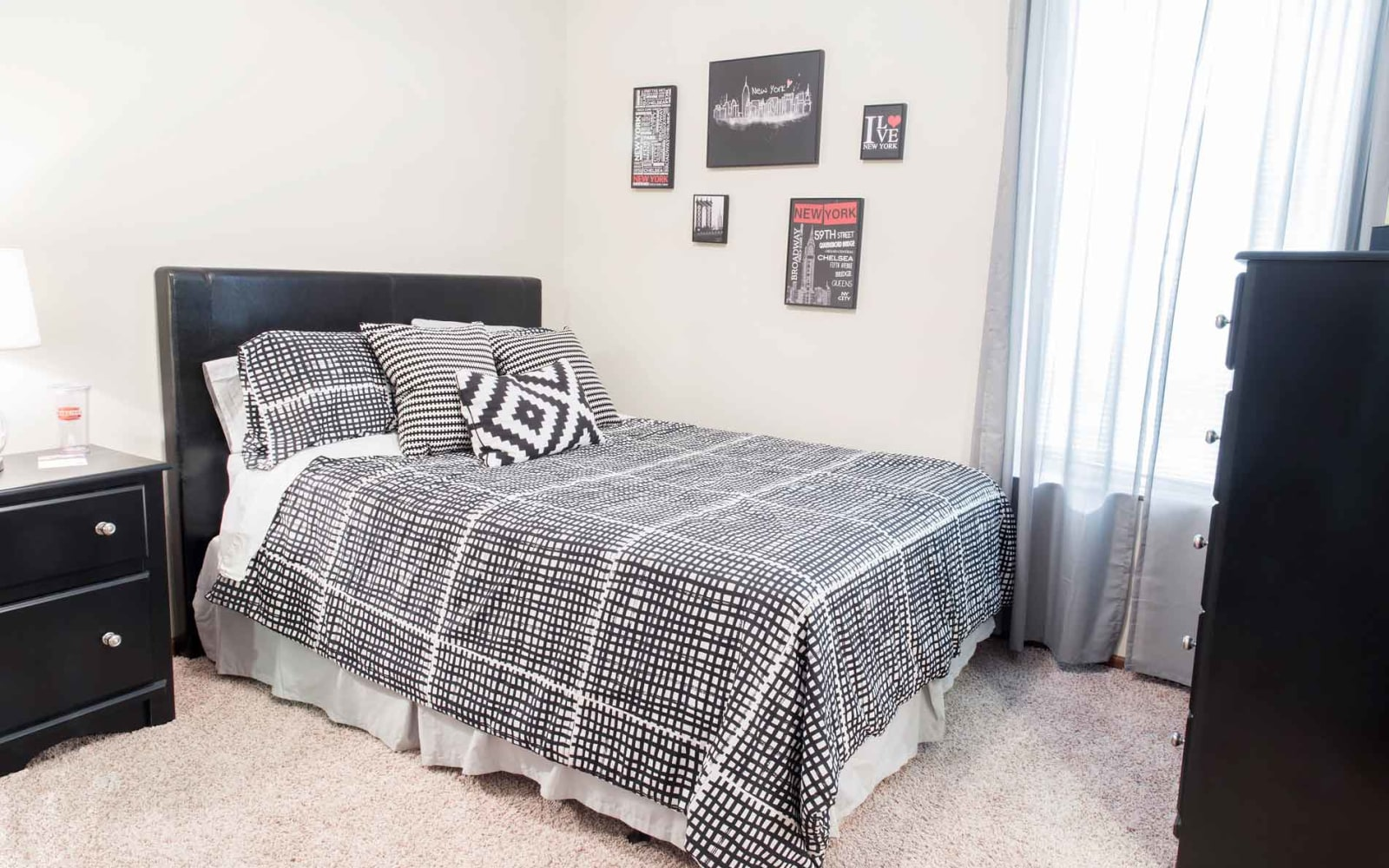 Spacious bedroom with a window at Prairie Pointe Student Living in Ankeny, Iowa