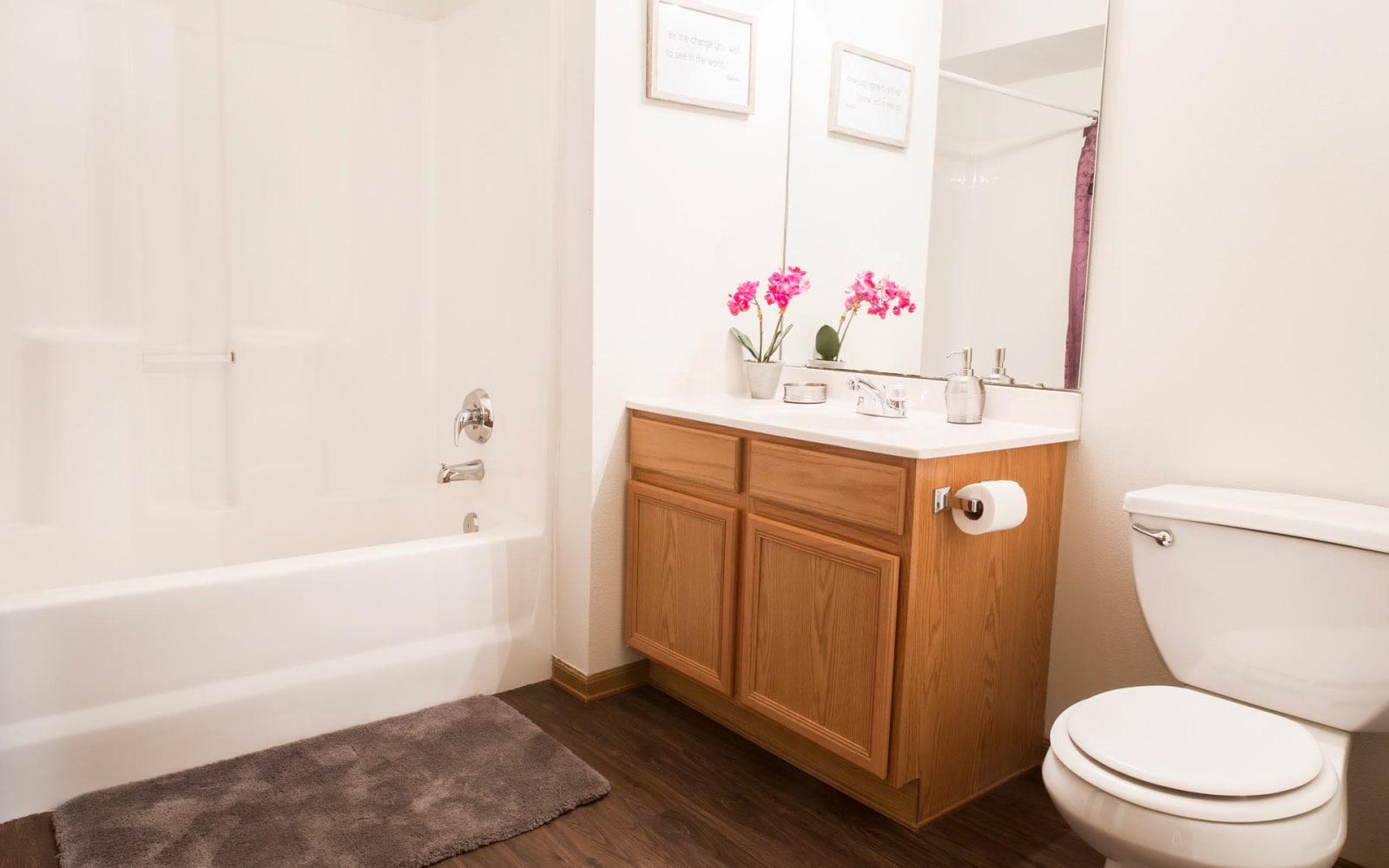 An apartment bathroom with a bathtub at Prairie Reserve in Cedar Rapids, Iowa