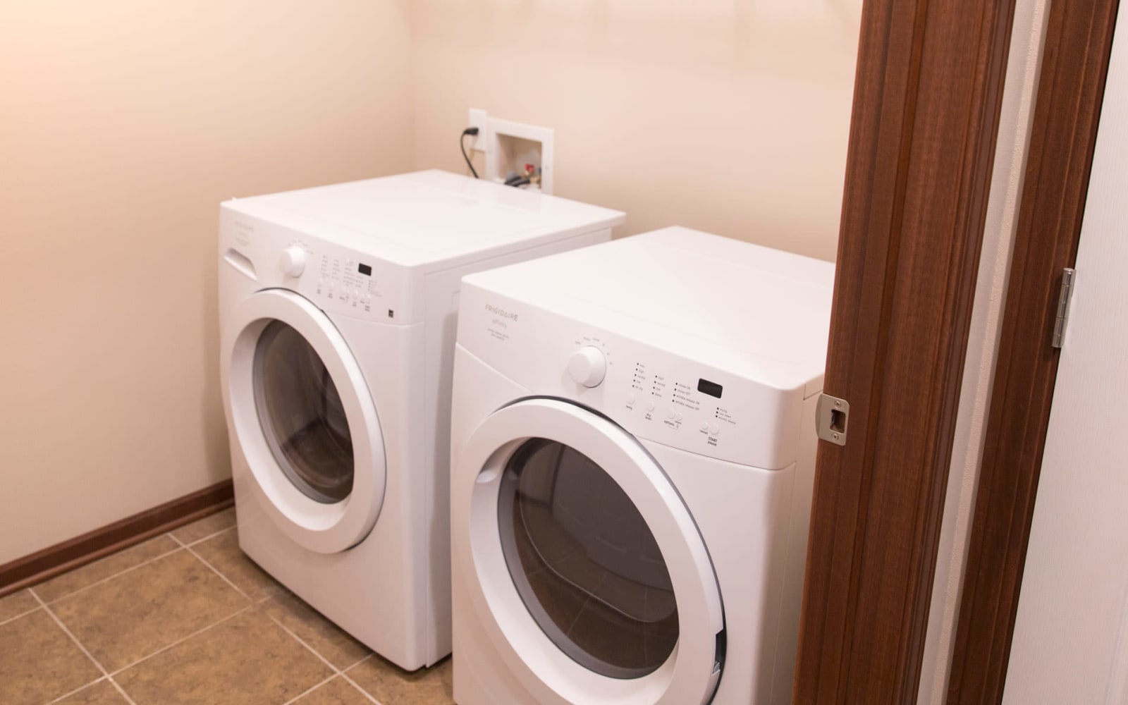 A full size washer and dryer in an apartment at Providence Pointe in Johnston, Iowa