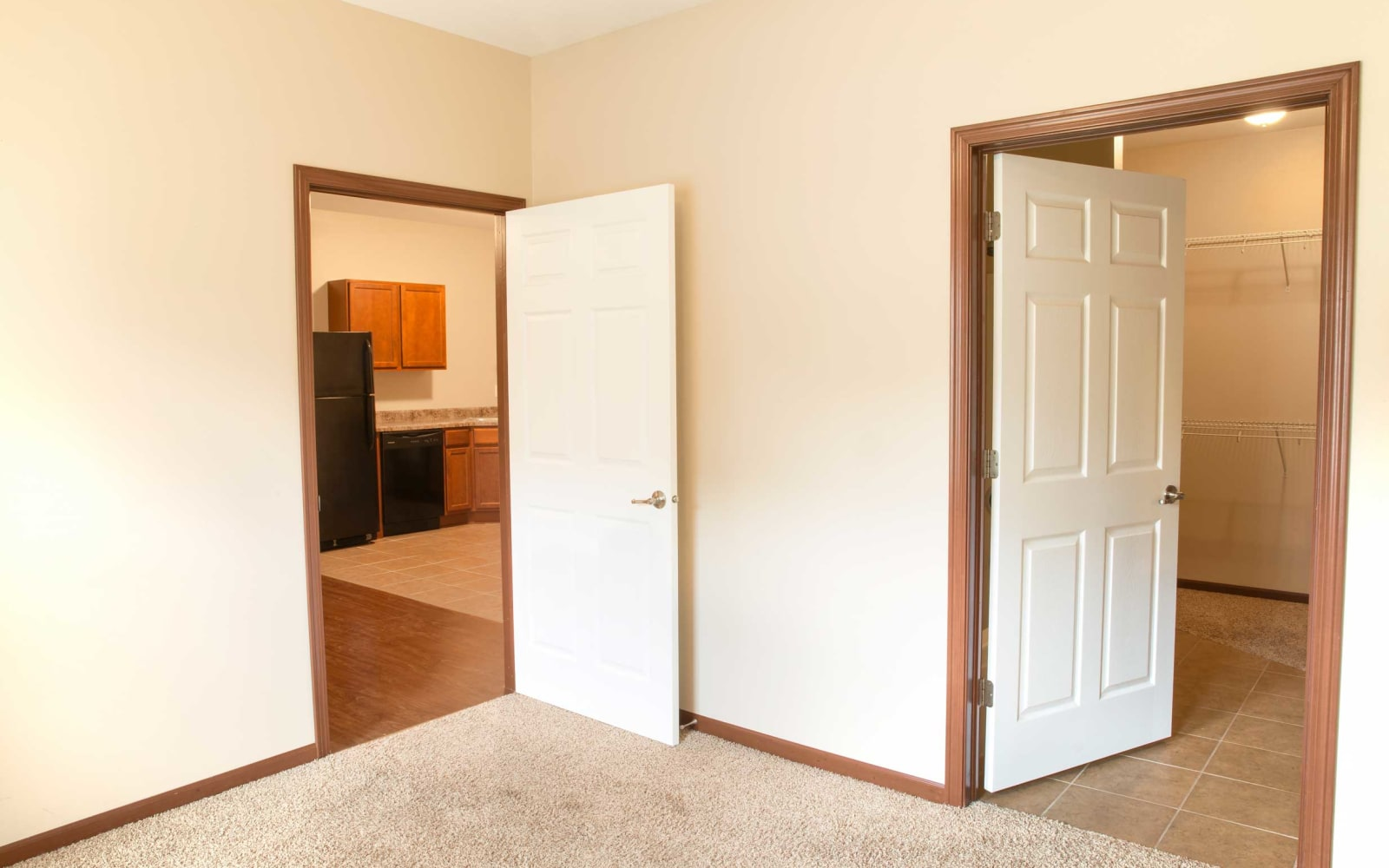 A bedroom to the right of the kitchen with a walk in closet at Westwood Village in Ames, Iowa