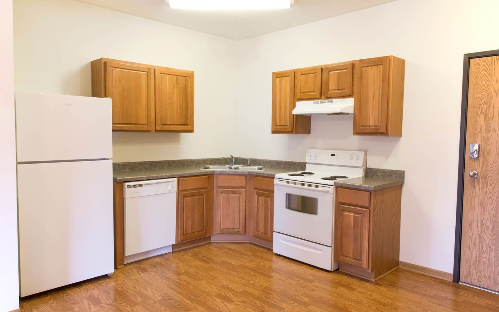Apartment kitchen with wood flooring at Westwood Village in Ames, Iowa