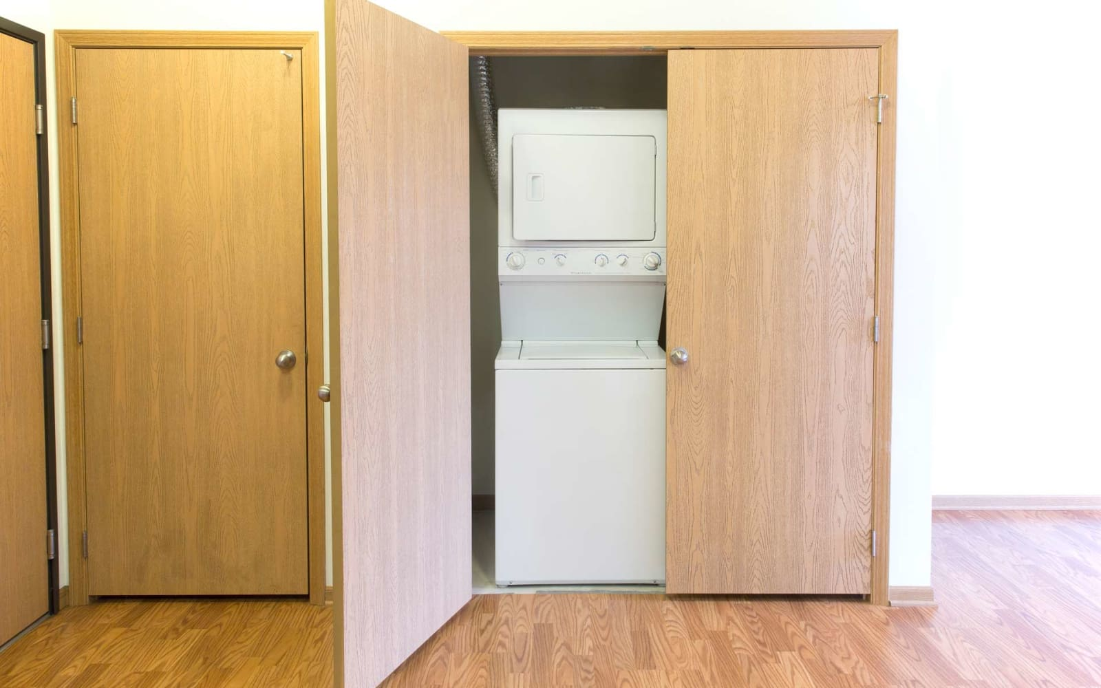 A stacked washer and dryer in it's own room at Westwood Village in Ames, Iowa