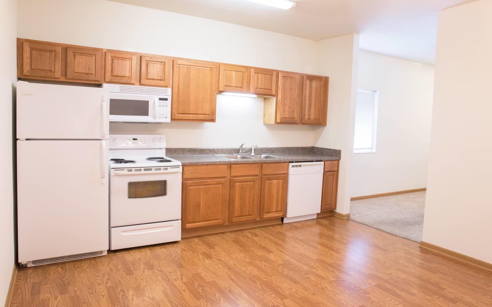 Apartment kitchen and dining room at Westwood Village in Ames, Iowa