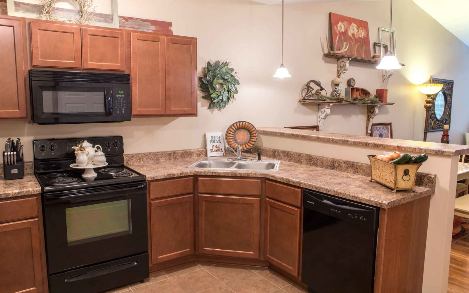 Apartment kitchen with tile flooring at Woodland Reserve in Ankeny, Iowa