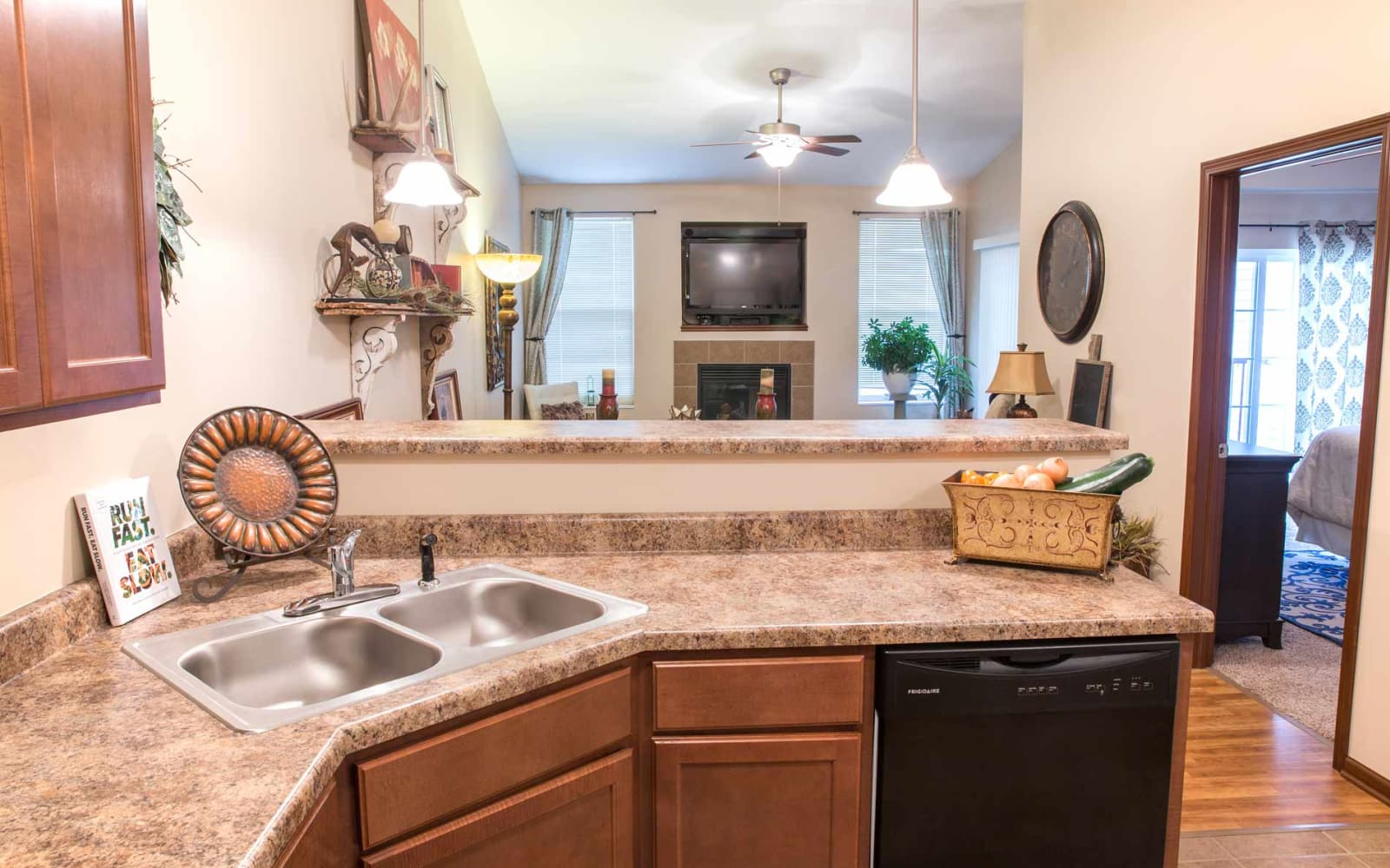 Kitchen facing the living room at Woodland Reserve in Ankeny, Iowa