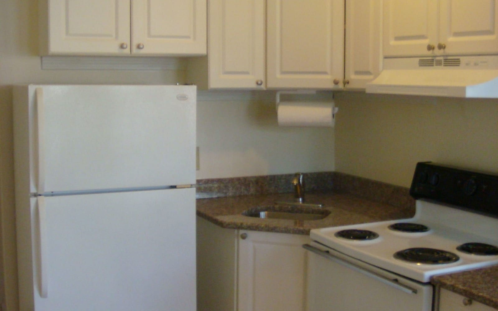 Stove and refrigerator in kitchen at 400 Atlantic in Bridgeport, Connecticut