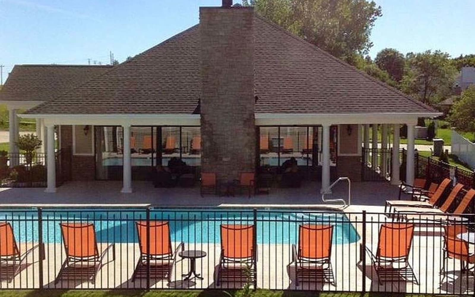Pool with lounge chairs at Aventura at Mid Rivers in Saint Charles, Missouri.