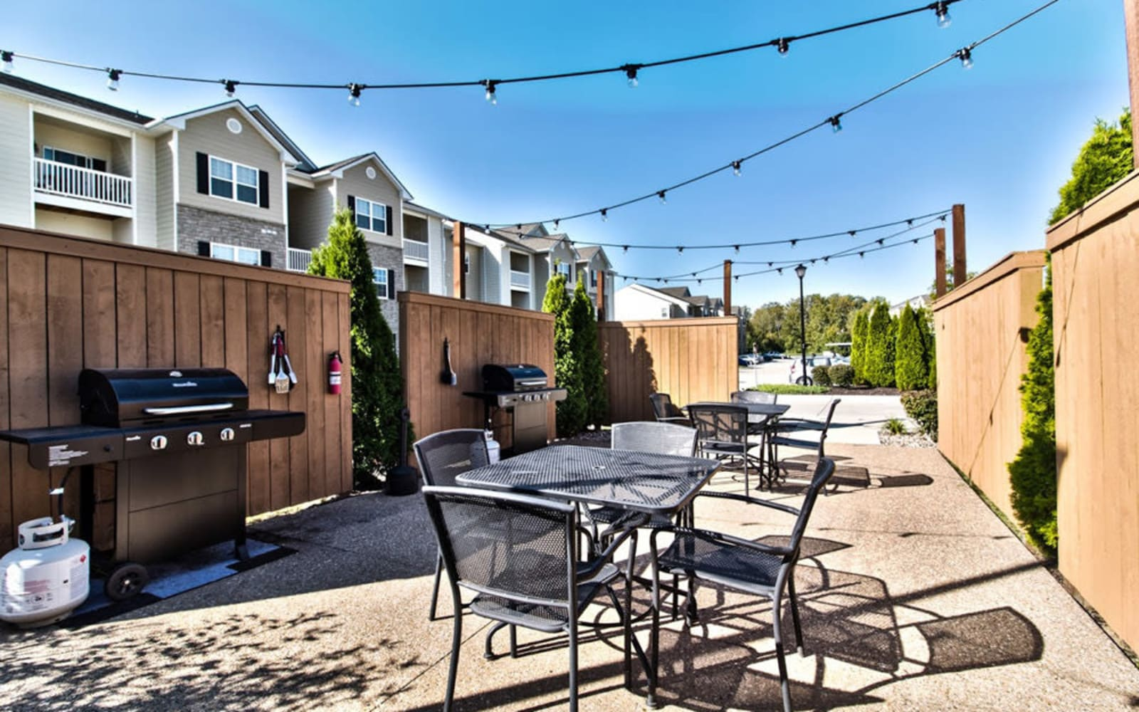 Outdoor dining area with grills at Aventura at Mid Rivers in Saint Charles, Missouri.