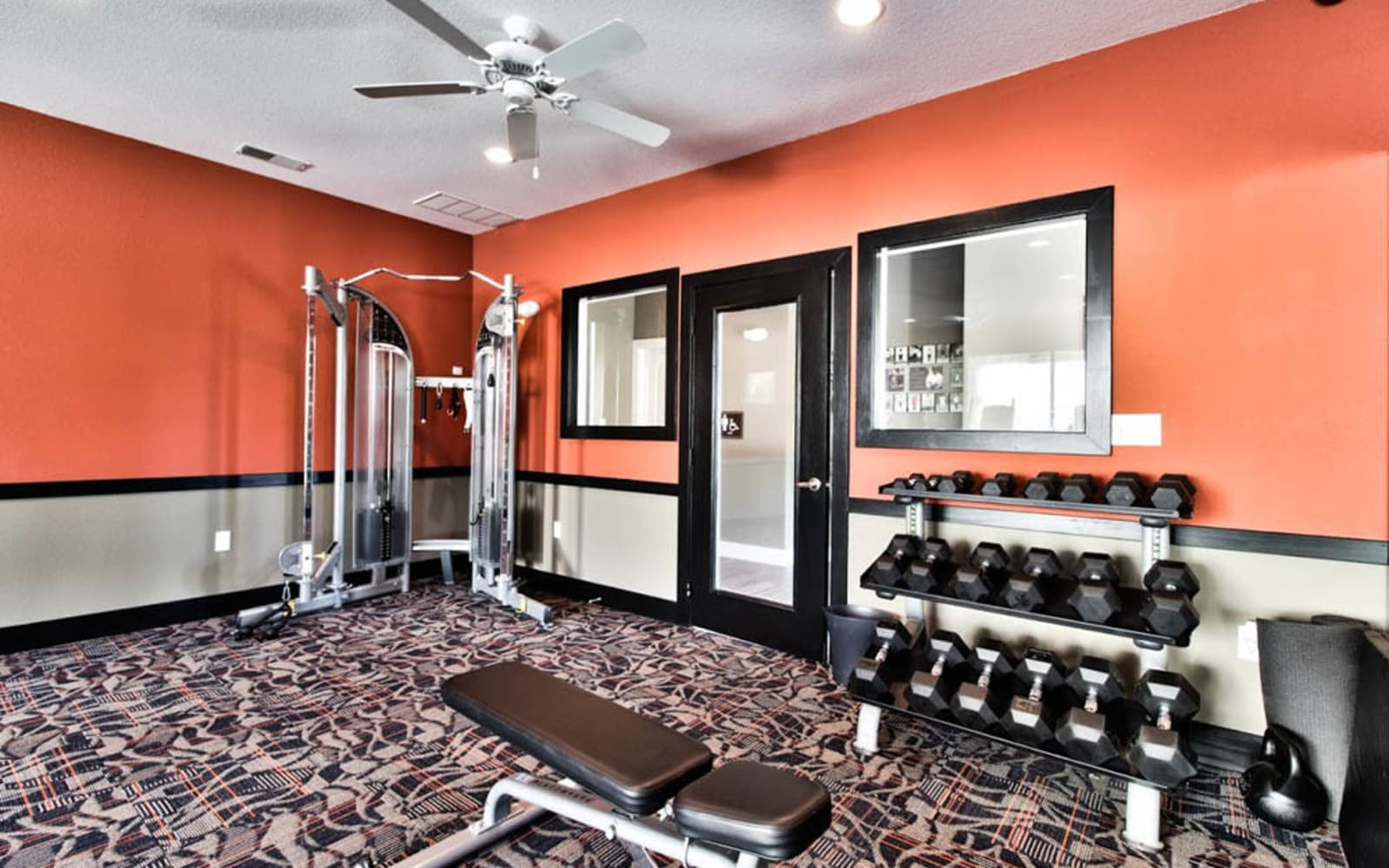 Fitness center with free weights at Aventura at Mid Rivers in Saint Charles, Missouri.
