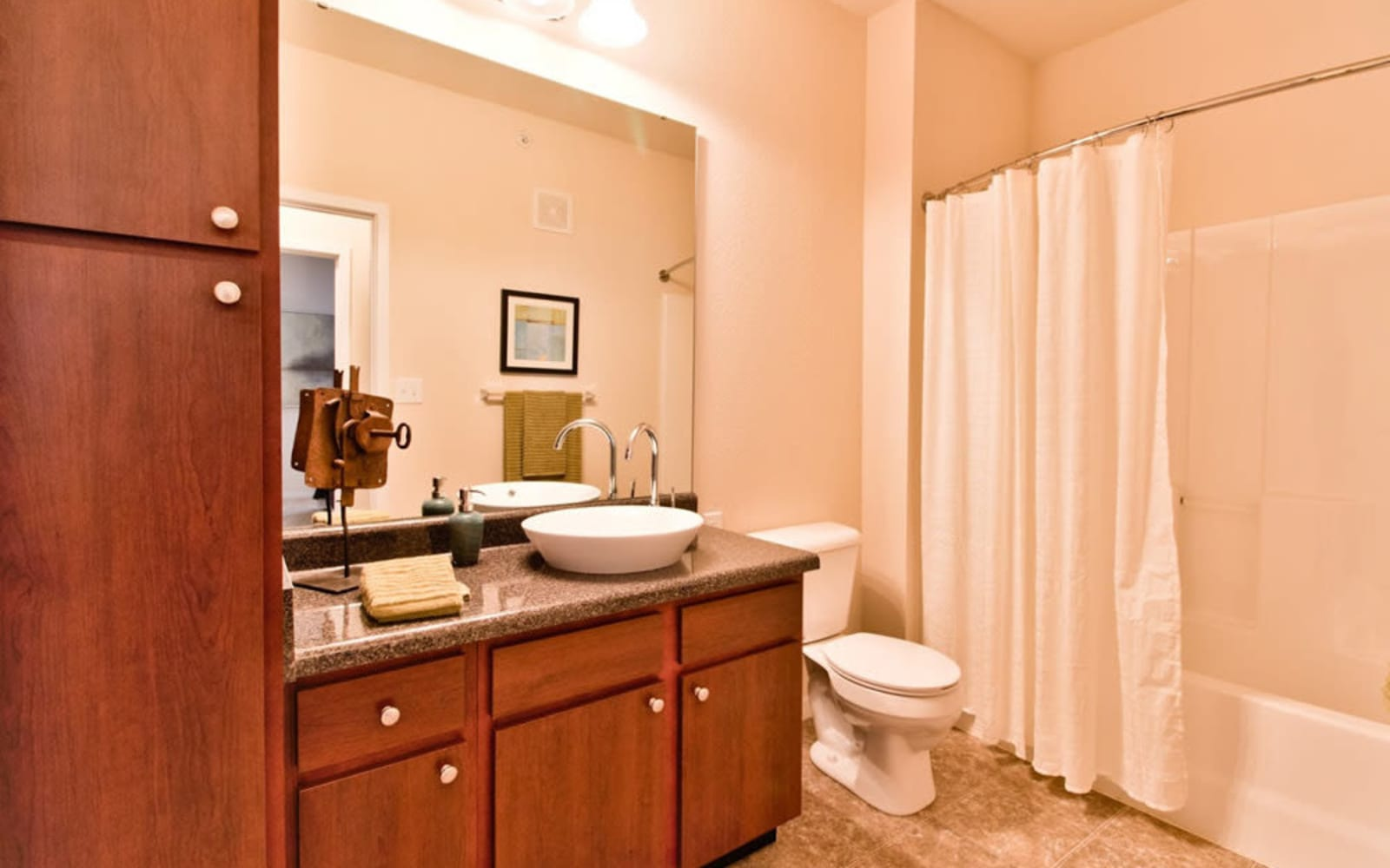 Bathrooms with plenty of cabinets at Aventura at Mid Rivers in Saint Charles, Missouri.