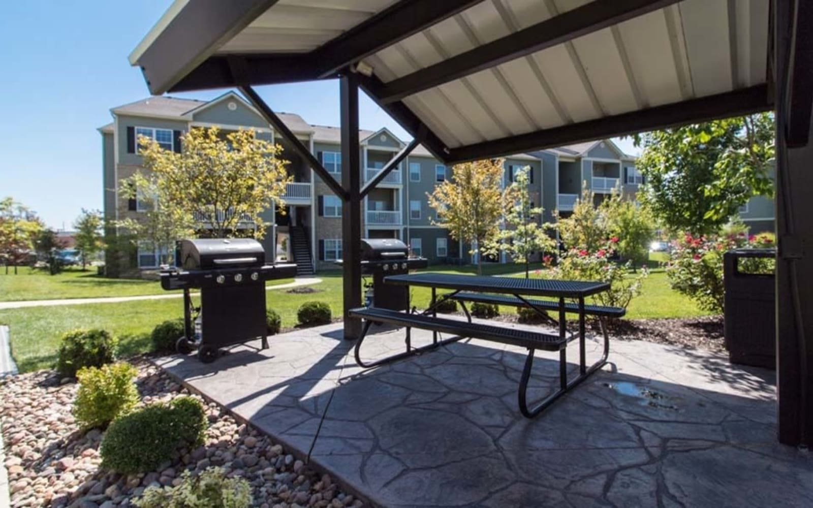 Outdoor seating and gas grills at Aventura at Richmond in Saint Peters, Missouri.