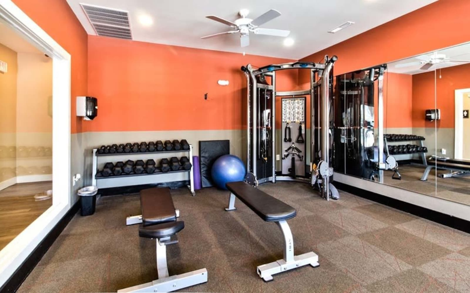Free weights section in fitness center at Aventura at Richmond in Saint Peters, Missouri.