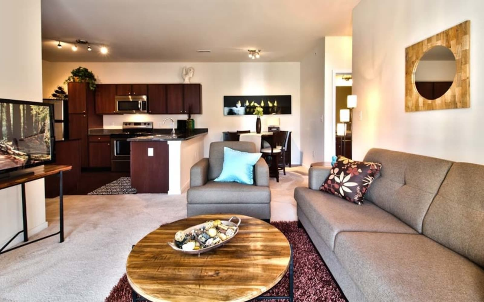 Large living rooms at Aventura at Richmond in Saint Peters, Missouri.
