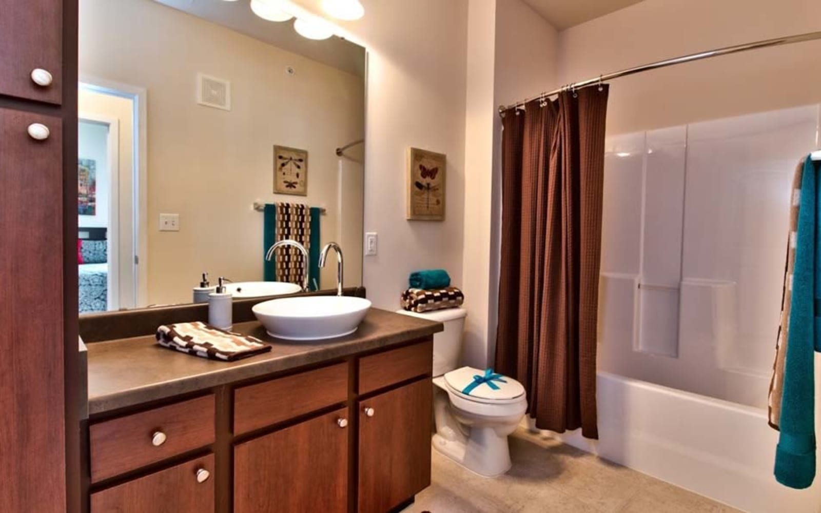 Bathrooms with storage space at Aventura at Richmond in Saint Peters, Missouri.