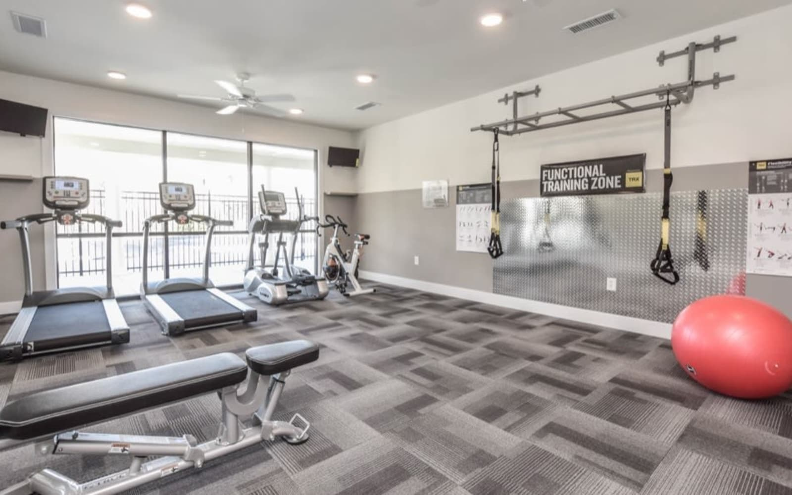 Fitness center with cardio machines at Aventura at Towne Centre in Ellisville, Missouri.