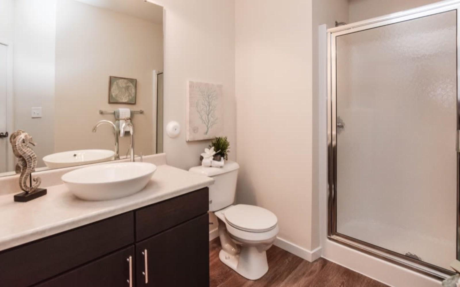 Large resident bathrooms at Aventura at Towne Centre in Ellisville, Missouri.