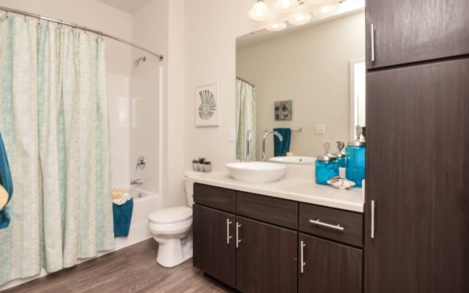 Bathrooms with plenty of storage space at Aventura at Towne Centre in Ellisville, Missouri.
