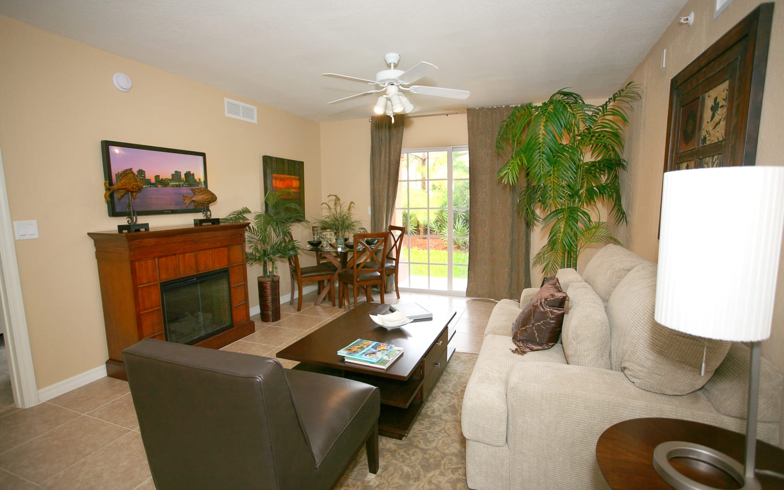Living room with a fireplace at Green Cay Village in Boynton Beach, Florida