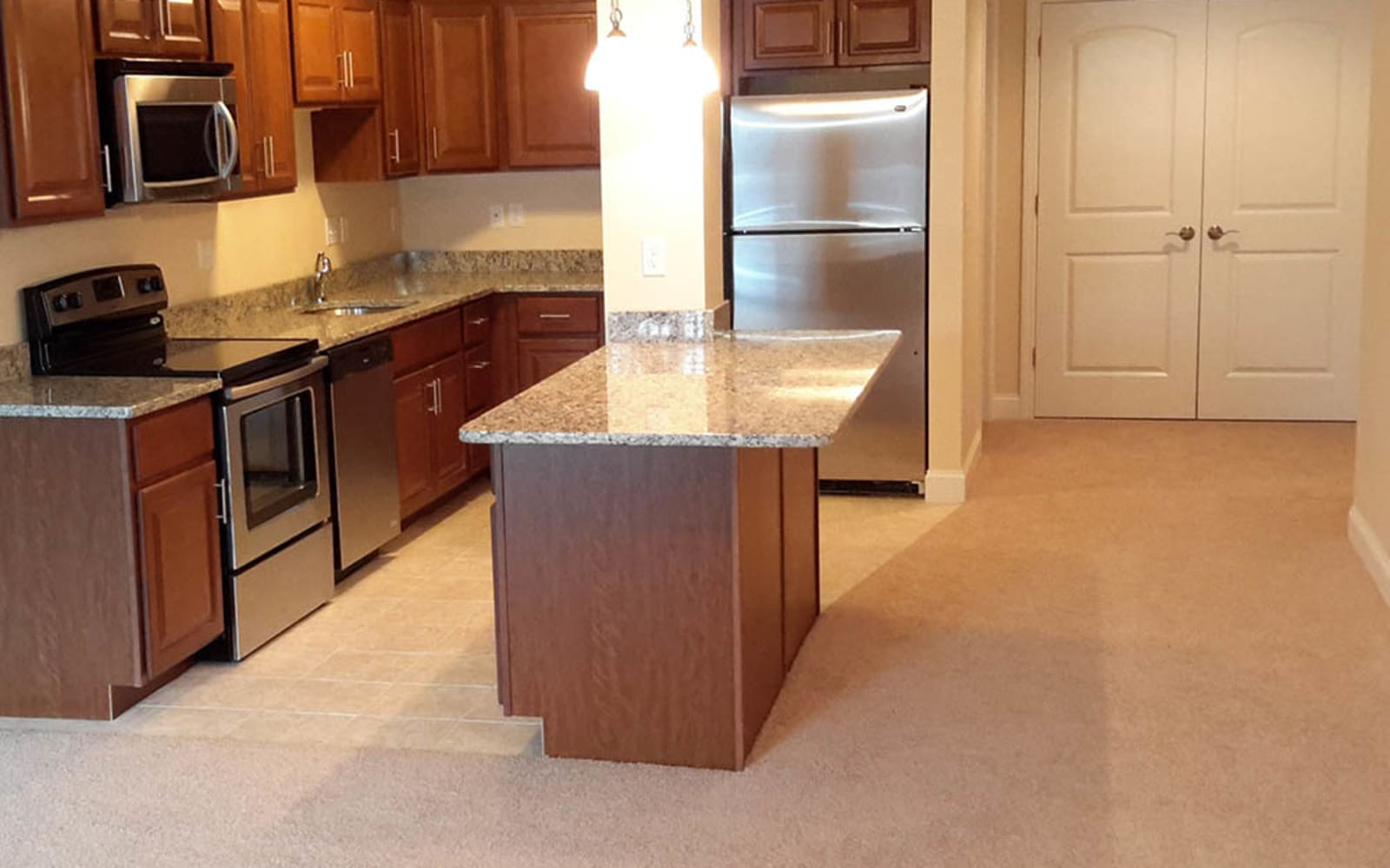 Convenient kitchen island at Grassfields Commons in Dracut, Massachusetts