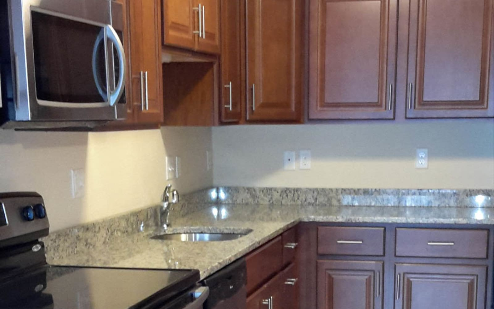 Kitchen with modern appliances at Grassfields Commons in Dracut, Massachusetts