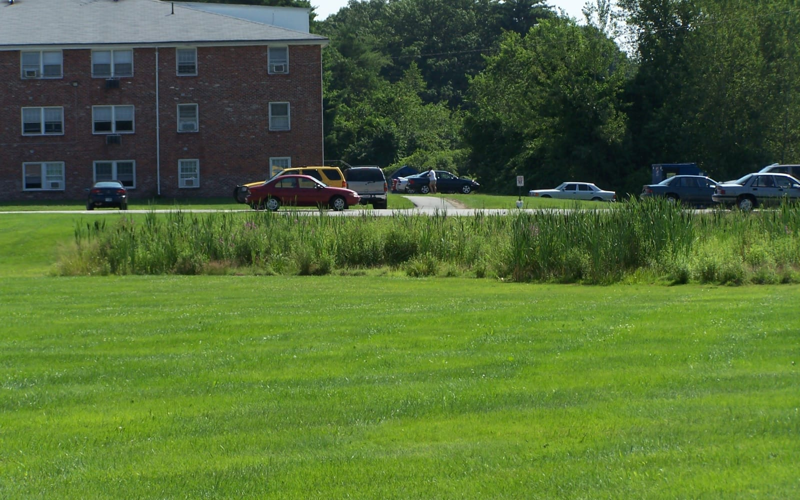 Enjoy well-maintained green grass outside of Westgate Arms Apartments in Salem, New Hampshire