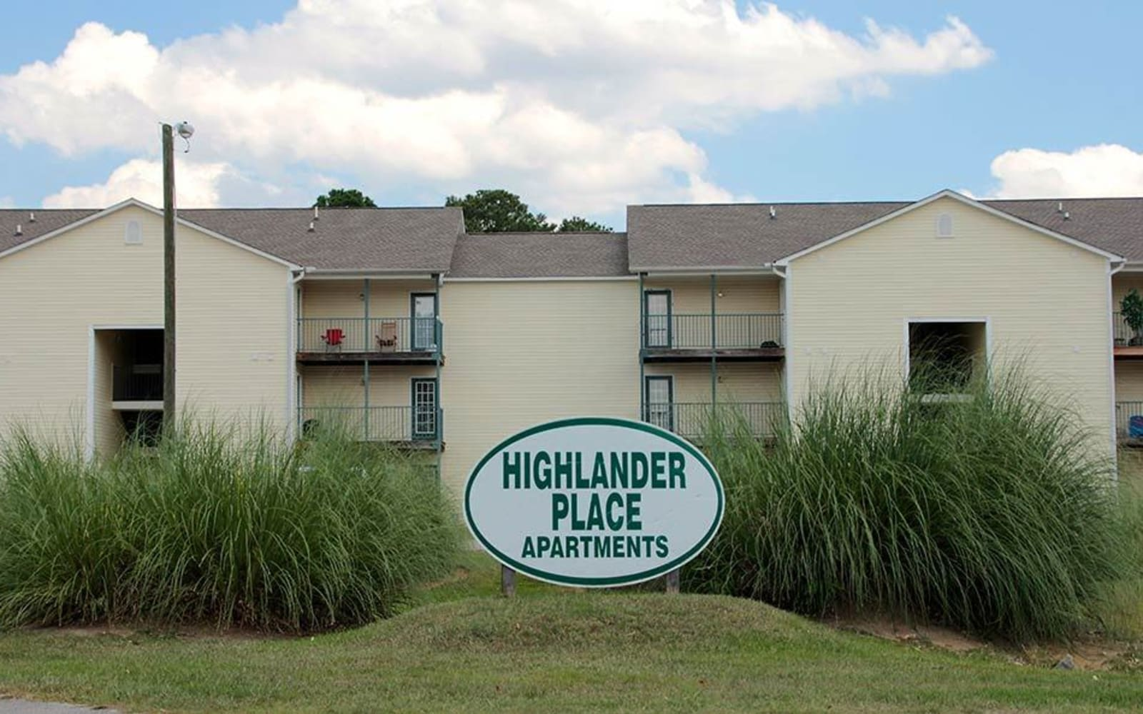 Sign in front of building at Highlander Apartments in Fayetteville, North Carolina