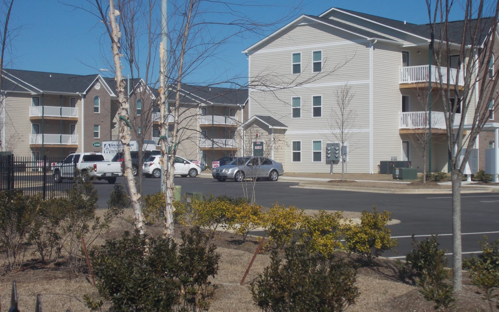 Landscaping and parking lot at Wedgefield Apartments in Raeford, North Carolina