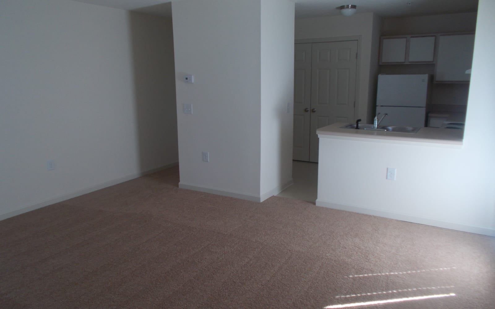 Living room and view of kitchen at Wedgefield Apartments in Raeford, North Carolina
