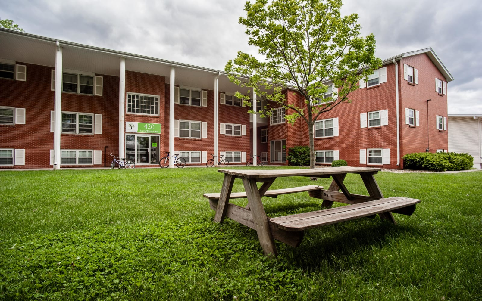 Apartment building with lush, green grass at South Meadow in Ames, Iowa.