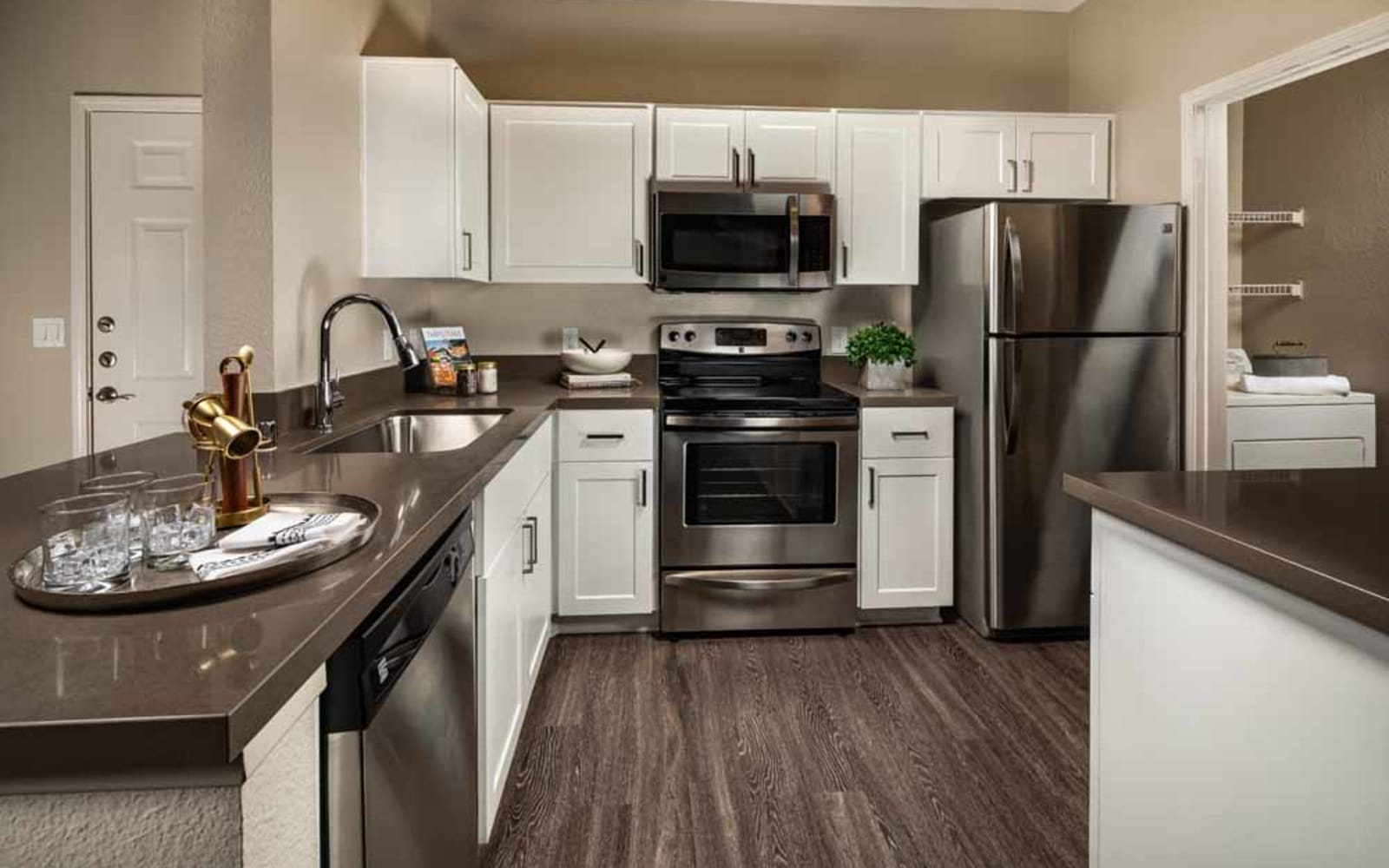 Stainless steel appliances in an apartment kitchen at Colonnade at Sycamore Highlands in Riverside, California
